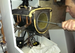 Cleaning the heat exchanger of a Procon 77H Boiler in Dumfries